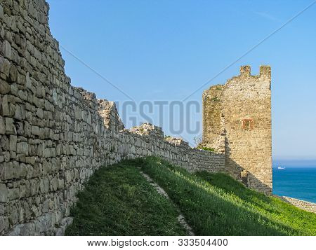 Crimea, The Ruins Of The Ancient Genoese Fortress Kafa In Feodosia. Remains Of A Wall And Corner Tow