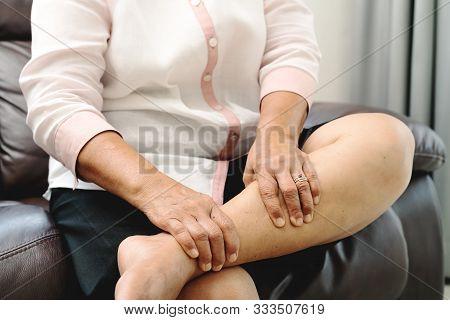 Leg Cramp, Senior Woman Suffering From Leg Cramp Pain At Home, Health Problem Concept