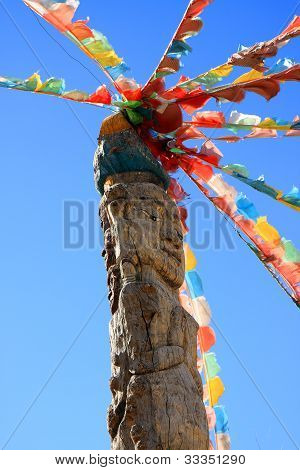 Totem Pole And Prayer Flags