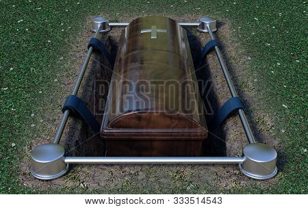 A Modern Wooden Coffin At A Funeral Being Lowered Into A Grave With A Lowering Mechanism A Dirt And
