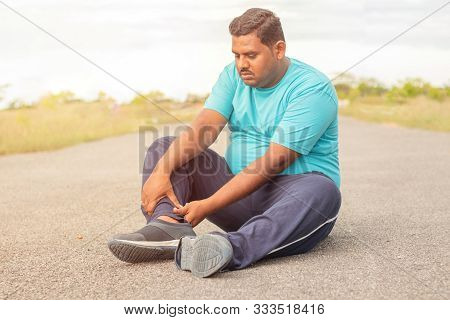 Concept Of Leg Tendon Injury Of Fat Man - Obese Person Holding Leg Suffering Muscle Pain - Overweigh