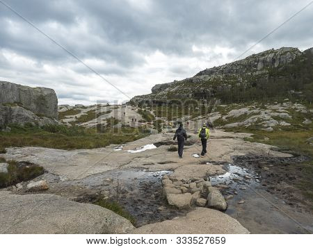 Songesand, Norway, September 9, 2019: Group Of Tourist People On Hike To Preikestolen Massive Cliff