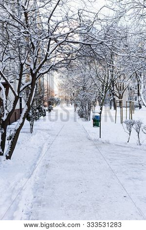 Sidewalk In The Snow In A Typical Polish Block Of Flats In Winter