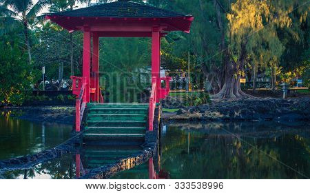 Pink Gazebo In A Park On A Pond  In Hilo, Hawaii