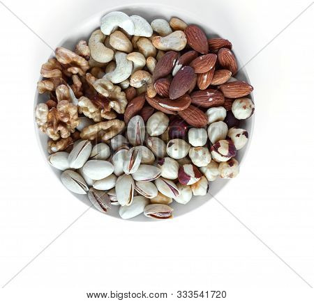 Healthy Food. Nuts Mix Assortment On White Grey Table Top View. Collection Of Different Legumes For