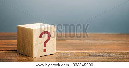 Wooden Block With A Question Mark. Asking Questions, Searching For Truth. Riddle Mystery, Investigat