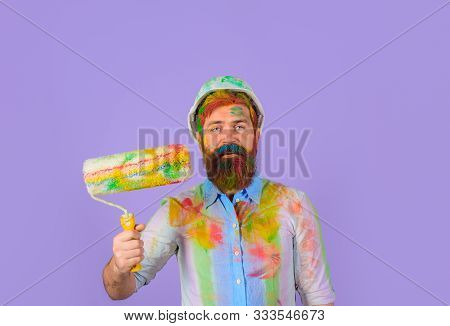 Painter Man. Handsome Bearded Worker With Paint Roller And Hard Hat. Painter Man With Paint Roller A