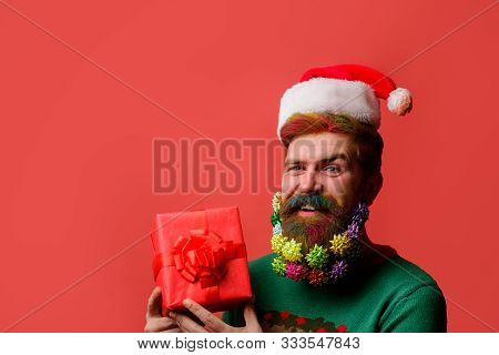 Santa Claus Holds Present. New Year Eve. Merry Christmas And Happy New Year. Wish You Merry Christma