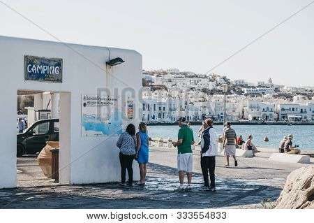 Mykonos Town, Greece - September 23, 2019: People Looking At The Town Map In The Old Port In Hora, A
