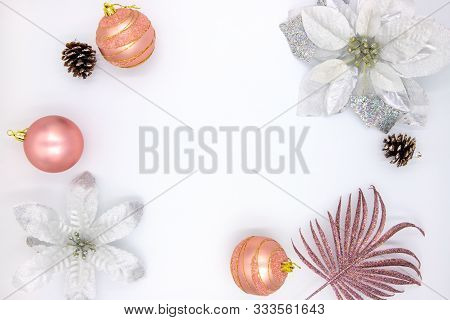 Christmas Flat Lay With Text Space And Fir Tree Decor. New Year Composition On White Background. Win