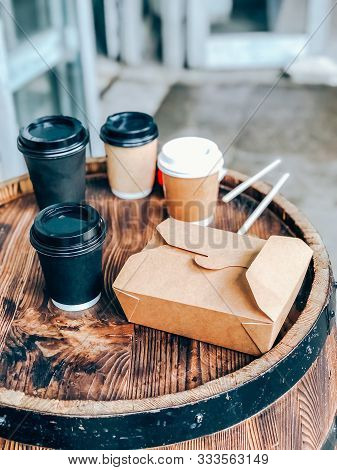 Coffee Cups And Street Food Craft Paper Container On A Wooden Outdoor Table. Street Market Food And