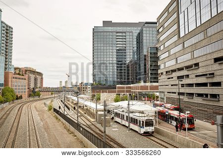 Denver, Colorado - May 19th, 2019: Lightrail And City Buses In Line Near Union Station And The Mille