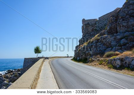The Watchtower Of The Ancient Fortress Hangs From The Cliff Above The Road. Turn The Highway Passing