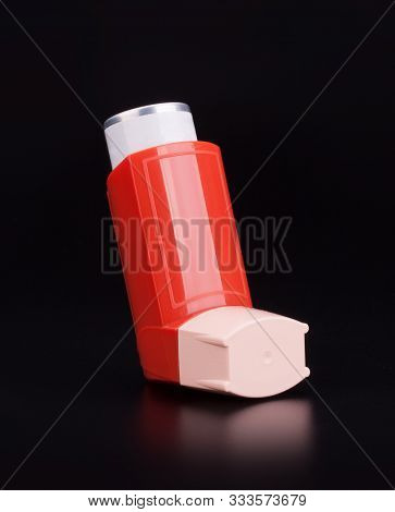 Closeup On  Bronchitis Asthma Inhaler On Black Background