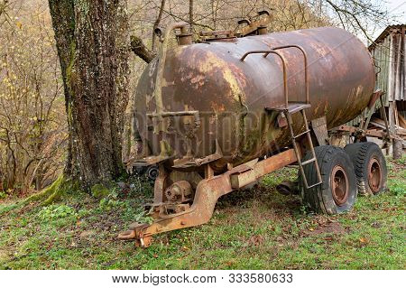 Rusty Tank. Old Rusty Tank Truck With Pump Mechanism. Old Abandoned Machinery.