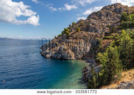 Beach With Rocks And Vegetation In Hydra Island, Greece
