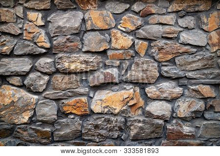 Stone Wall. Wall Of Hewn Wild Stone. Stone Background. Stone Texture For Creativity.