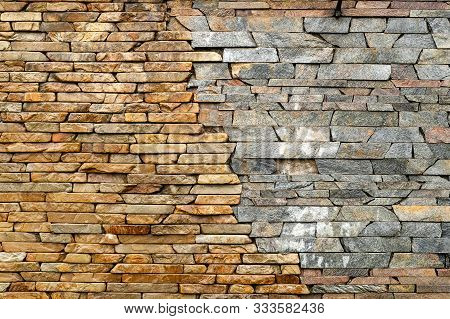 Stone Wall. Masonry Walls Made Of Rough Stone Hewn Wet Discord Color. Stone Background. Stone Textur