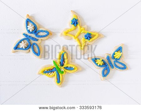 Homemade shortbread or sugar cookies in the shape of butterflies.