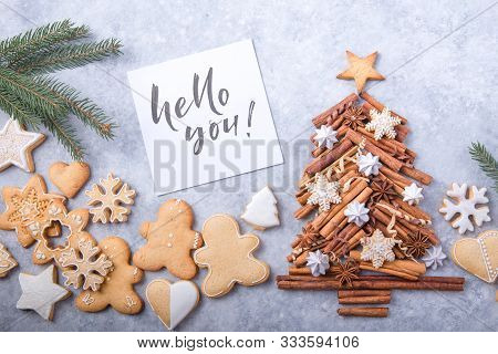Christmas Tree Made Of Cinnamon With Traditional Gingerbread Cookies On Grey Background, Space For T