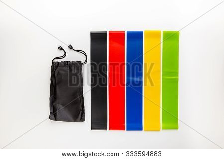 Multi-colored Elastic Rubber Bands For Fitness On A White Background. A Set Of Rubber Bands Of Diffe