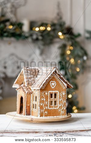 Gingerbread House, Concept Holiday Of Christmas And Happy New Year. Defocused Lights Of Christmas Tr