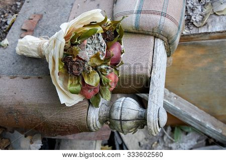 Bunch of rotten fruit and wilted flowers as a symbol of a destroyed old life. poster