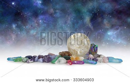 Cosmic Space Crystals Background Banner - Huge Rutilated Crystal Ball Surrounded By Tumbled Healing
