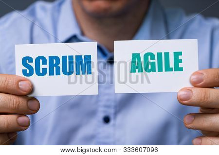 Man Showing Cards With Scrum And Agile Text