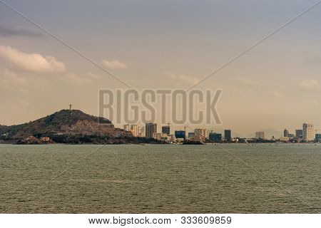 Vung Tau, Vietnam - March 12, 2019: Skyline Of The City With High Rise Buildings Adjacent To Forest
