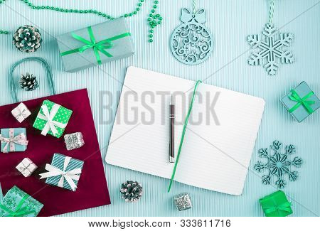 Wish List With Pen Among Christmas Wrapped Gifts And Decoration Color Inversion