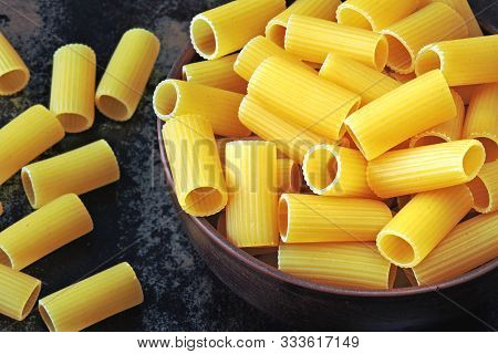 Raw Rigatoni Pasta In A Bowl. Italian Rigatoni