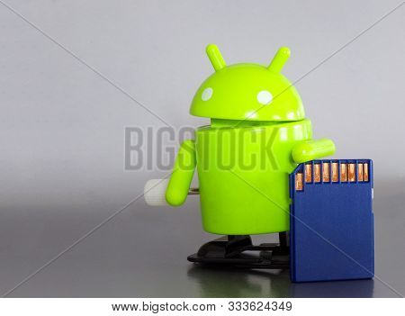 The Figure Of The Android With A Usb Flash Drive. Android Operating System.