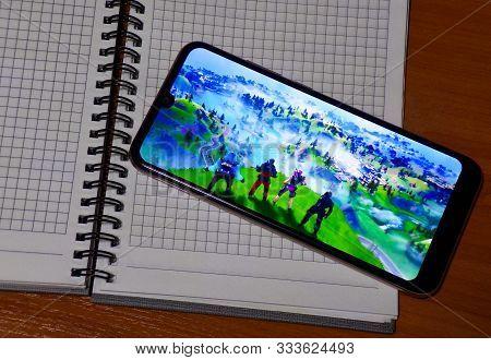 Fortnite Mobile Game On Mobile Phone Display.