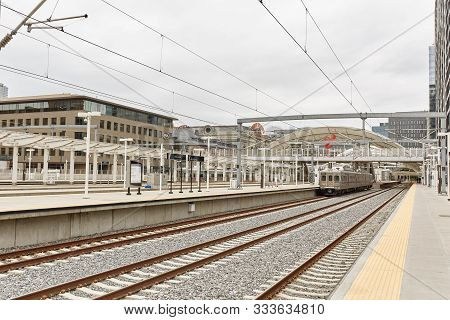 Denver, Colorado - May 19th, 2019: Condominiums And Highrise Buildings Behind Train Tracks Downtown