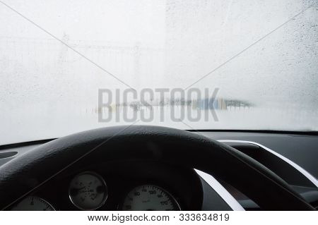 Close Up Footage Of A Car Windshield, Frost On The Windshield Of The Car. View From The Drivers Side