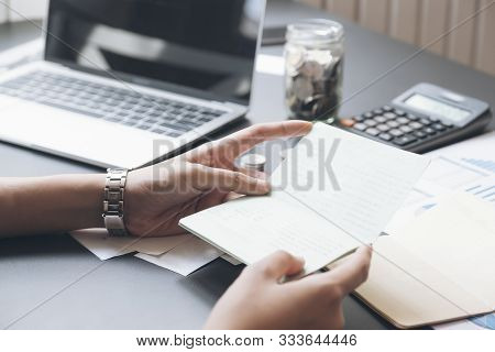 Accountant Hands Holding Saving Account Passbook, Book Bank. Business Account Saving Concept.