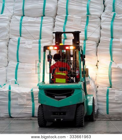 Forklift Operation In Warehouse, Lifting Cargo In Jumbo Bag Into Stack.