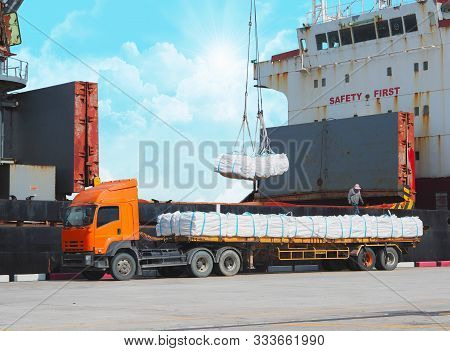 Loading Refine Sugar In Jumbo Bag Into Vessel Hold. Cargo Delivery And Shipping