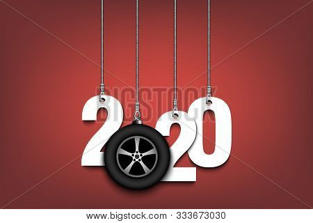 2020 New Year And Car Wheel As A Christmas Decorations Hanging On Strings. 2020 Hang On Cords On An