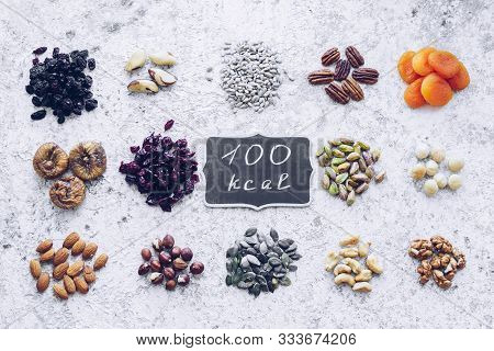 100 Calories Portion Healthy Snack Of Nuts, Seeds And Dried Fruits - Pecans, Hazelnuts, Walnuts, Pis