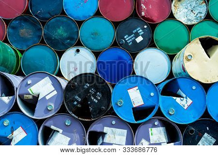 Old Chemical Barrels. Blue, Green, And Red Oil Drum. Steel Oil Tank. Toxic Waste Warehouse. Hazard C