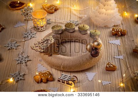 Advent Wreath With Candles On Wooden Background