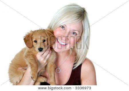 Pretty Blond Girl Holding Puppy