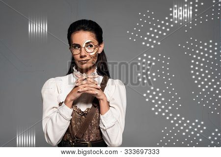 Dreamy Steampunk Woman Looking Away With Clenched Hands Near Digital Illustration Isolated On Grey