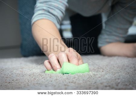 Woman Washing Carpet With Hands. Woman Washing Carpet At Home. Domestic Lifestyle. Woman At Home Was