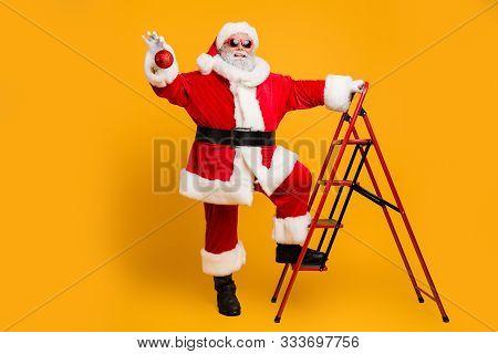 Full Body Photo Of Funny Funky Grey Hair Santa Claus Climb Stairs Want Hang Christmas Tinsels Decora