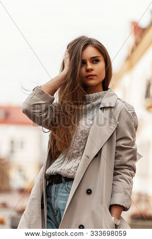 Pretty Urban Young Woman Straightens Hair. Beautiful Stylish Girl A Fashion Model In A Fashionable T