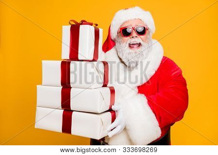 Portrait Of Funny Funky Grey Hair Santa Claus In Red Hat Hold Packages He Brings For Good Kids Peopl
