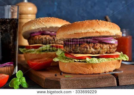 Homemade Hamburger With Beef, Cheese And Sauce On A Concrete Background. Horizontal.